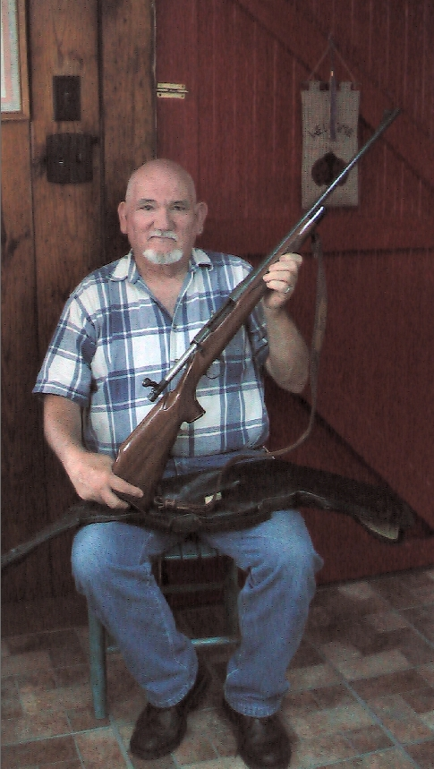 Larry McGowan holding rifle smaller